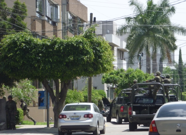 Mexican armed forces raiding the home of a drug lord in Guadalajara, Jalisco last year.
