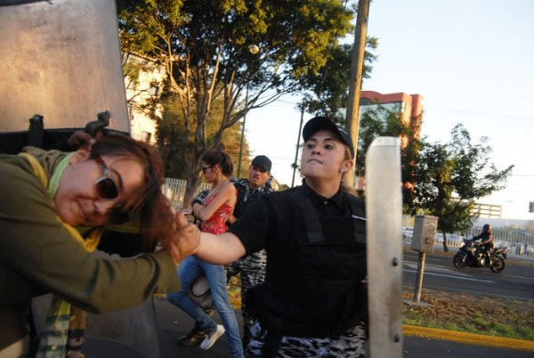 """The police were abusive, they became more violent than the students,"" said Reporter photographer Juana Cazares."