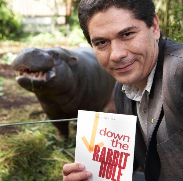 Juan Pablo Villalobos poses with a Liberian pygmy hippopotamus.