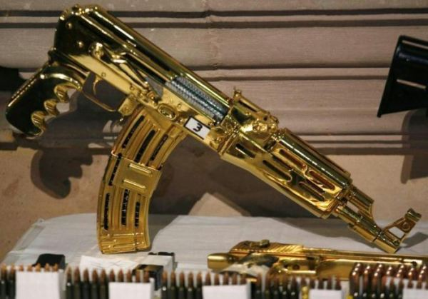 Authorities recovered a number of gold-plated military-grade firearms at  Ye Gon's home.