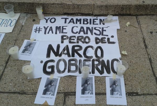 """I'm tired too, but of the narco government,"" reads this sign."