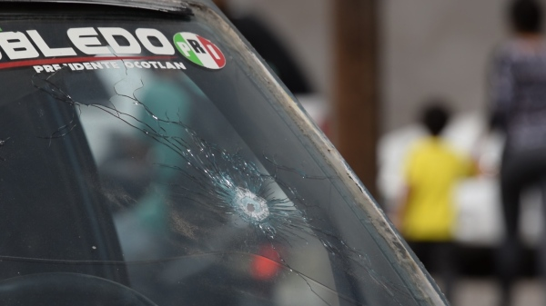 A bullet punctured the windshield of a vehicle in the community of Ocotlán, Jalisco, after a March 19 shootout that left 11 people dead. (Photo by Victor Hugo Ornelas/VICE News)