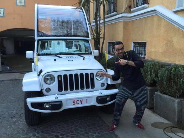 Joe Ibarra posing with the Popemobil at the Vatican embassy in Mexico City.