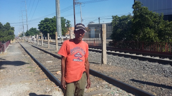 A Honduran migrant from San Pedro Sula, the world's murder capital, beside the train tracks in Guadalajara.