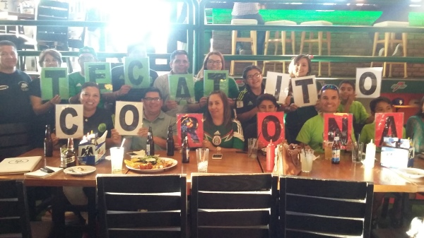 Corona's family cheering him on at a bar in Hermosillo.