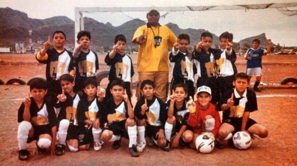 Tecatito with his childhood team. He's the one kneeling in front of the coach. Courtesy Corona family.