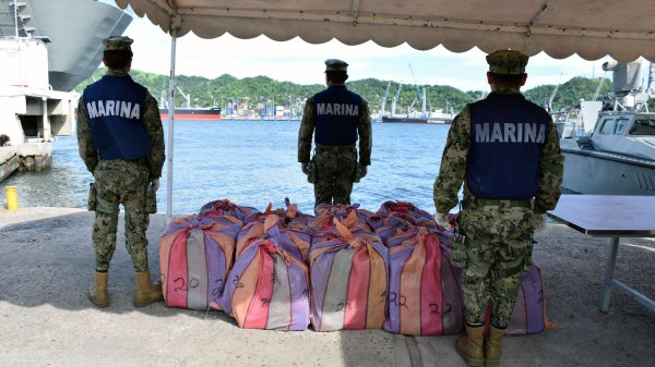 Marines guard 806 kilos of cocaine they seized from a speedboat approaching the port of Manzanillo in August.