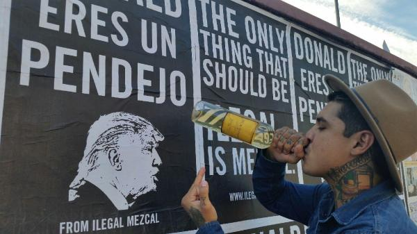 Mexico's Ilegal Mezcal put up posters emblazoned with the slogan: 'Donald eres un pendejo' (Donald you're an asshole).