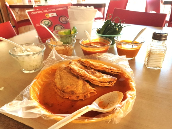 "Most people at Tacos Charlie order their tacos ""bañados""—literally bathed in sauce."