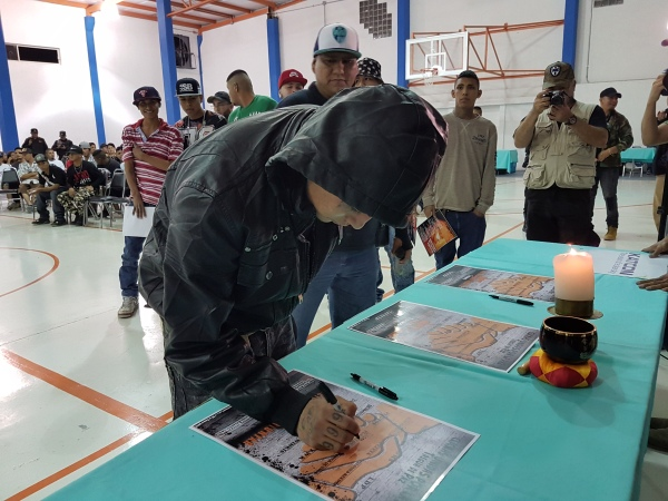The leaders of 13 warring street gangs gathered to sign a truce in a gym hall in Monterrey in January.